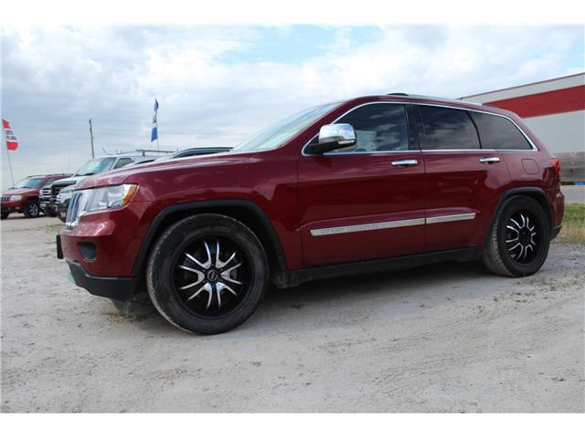 2013 Jeep Grand Cherokee Overland (Stk: P9167) in Headingley - Image 1 of 3