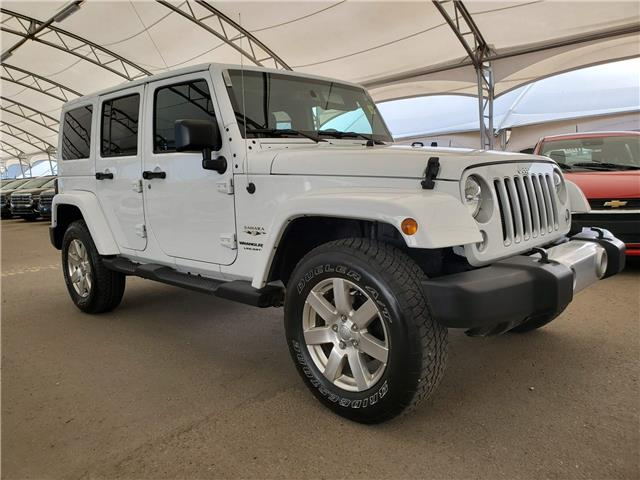 2018 Jeep Wrangler JK Unlimited Sahara (Stk: 185969) in AIRDRIE - Image 1 of 23