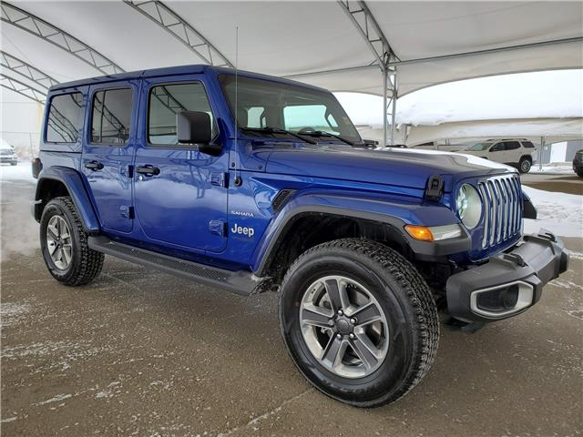 2019 Jeep Wrangler Unlimited Sahara 1C4HJXEN4KW670311 187004 in AIRDRIE
