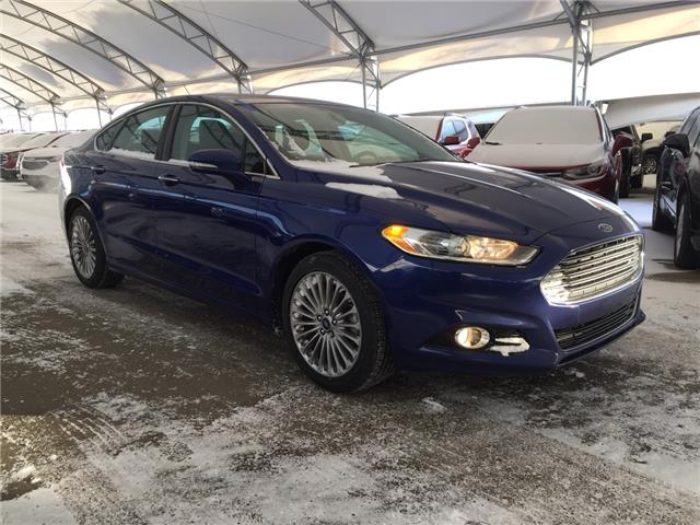 2014 Ford Fusion Titanium (Stk: 179121) in AIRDRIE - Image 1 of 35