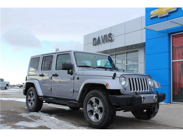 2018 Jeep Wrangler JK Unlimited Sahara (Stk: 215190) in Claresholm - Image 1 of 22
