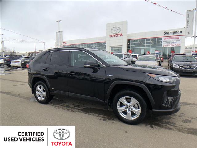 2019 Toyota RAV4 Hybrid LE (Stk: 9050A) in Calgary - Image 1 of 11