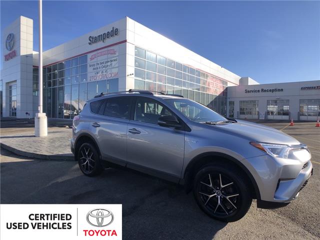 2018 Toyota RAV4 Hybrid SE (Stk: 9338A) in Calgary - Image 1 of 25