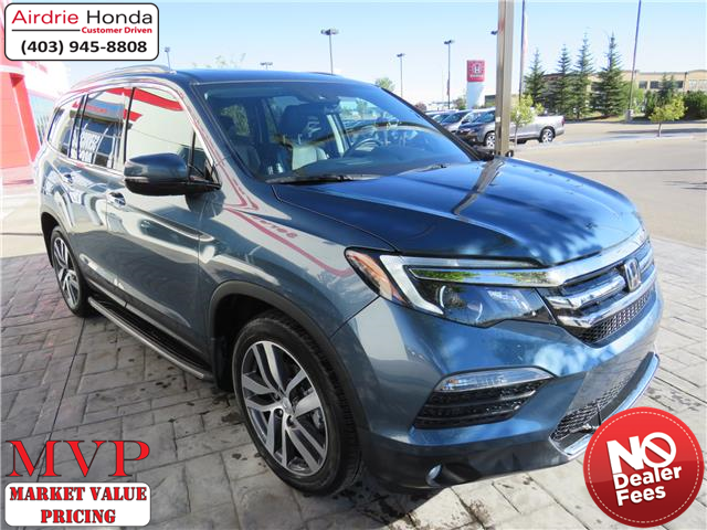 2018 Honda Pilot Touring (Stk: 210001A) in Airdrie - Image 1 of 8