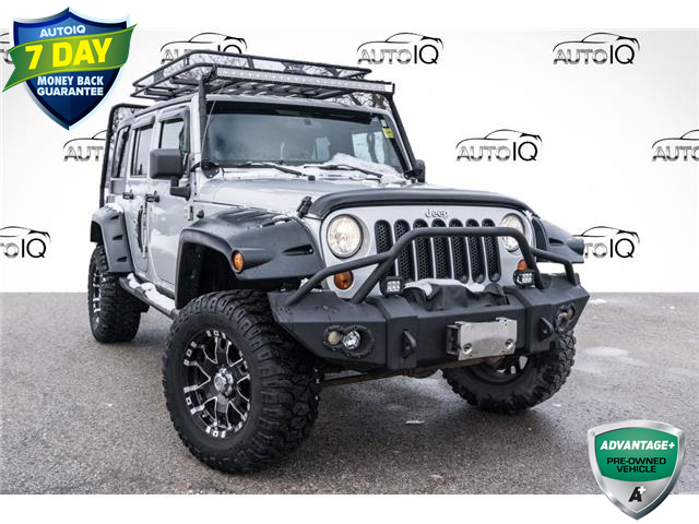 2012 Jeep Wrangler Unlimited Sahara (Stk: 34636AU) in Barrie - Image 1 of 18