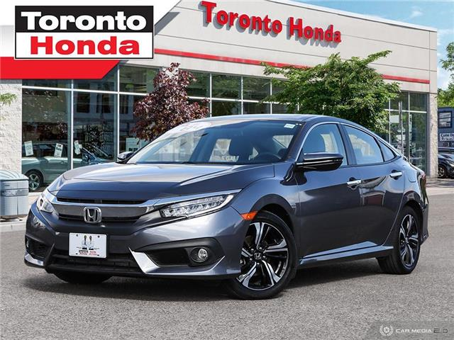 2018 Honda Civic Sedan Touring We are open!! Roof-Leather-Wireless Chargi (Stk: H40782T) in Toronto - Image 1 of 27