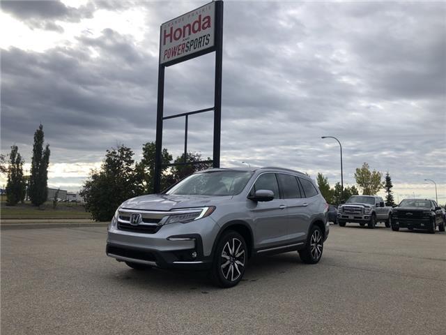 2021 Honda Pilot Touring 8P (Stk: H16-1599) in Grande Prairie - Image 1 of 19