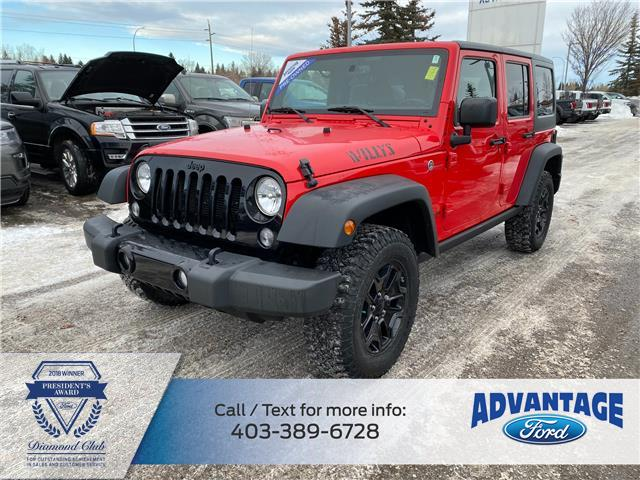 2016 Jeep Wrangler Unlimited Sport (Stk: L-1604A) in Calgary - Image 1 of 21