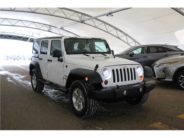 2011 Jeep Wrangler Unlimited Sport (Stk: 210045A) in Calgary - Image 1 of 21