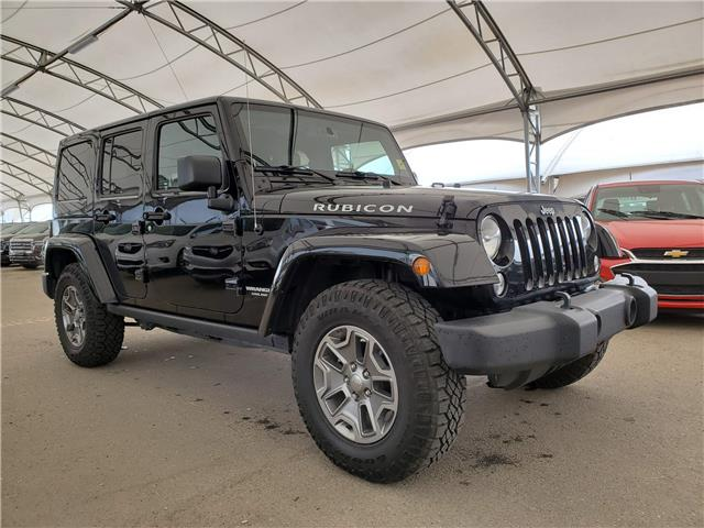 2016 Jeep Wrangler Unlimited Rubicon 1C4BJWFG5GL244622 184935 in AIRDRIE