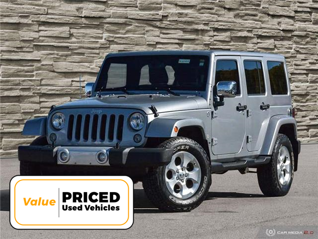 2014 Jeep Wrangler Unlimited Sahara (Stk: M2012A) in Welland - Image 1 of 27