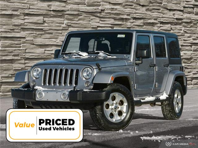 2015 Jeep Wrangler Unlimited Sahara (Stk: M2062A) in Welland - Image 1 of 27