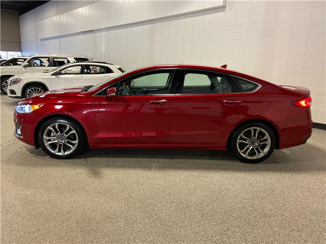 2020 Ford Fusion Hybrid Titanium (Stk: P12590) in Calgary - Image 1 of 24