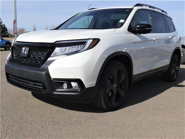 2019 Honda Passport Touring (Stk: HHM115A) in Lloydminster - Image 1 of 21