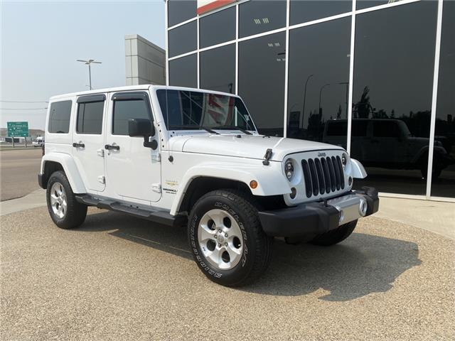 2015 Jeep Wrangler Unlimited Sahara (Stk: P1580A) in Medicine Hat - Image 1 of 10