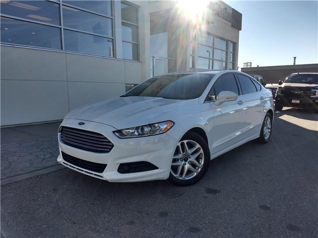 2014 Ford Fusion SE (Stk: NE077) in Calgary - Image 1 of 21