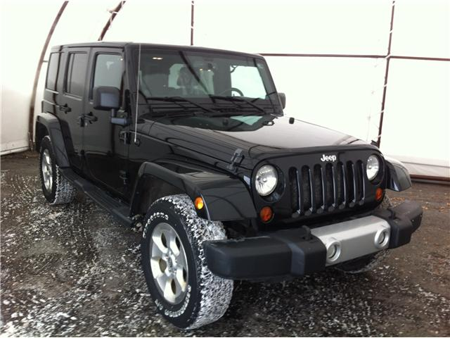 2013 Jeep Wrangler Unlimited Sahara (Stk: A8297A) in Ottawa - Image 1 of 21