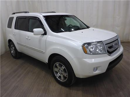 2011 Honda Pilot Touring (Stk: 19091877) in Calgary - Image 1 of 24
