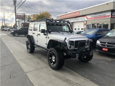 2012 Jeep Wrangler Unlimited Sahara (Stk: 1857) in Garson - Image 1 of 10