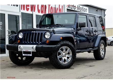 2013 Jeep Wrangler Unlimited Sahara (Stk: 191365) in Chatham - Image 1 of 22