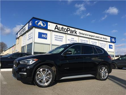 2018 BMW X1 xDrive28i (Stk: 18-92419) in Brampton - Image 1 of 28