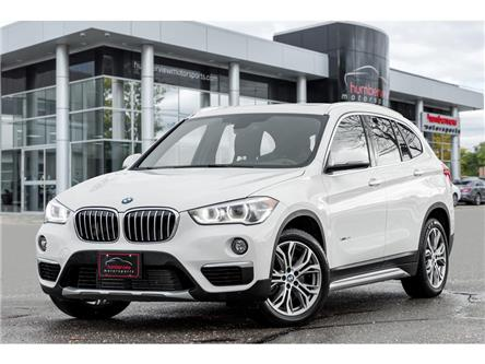 2018 BMW X1 xDrive28i (Stk: 19HMS1393) in Mississauga - Image 1 of 20