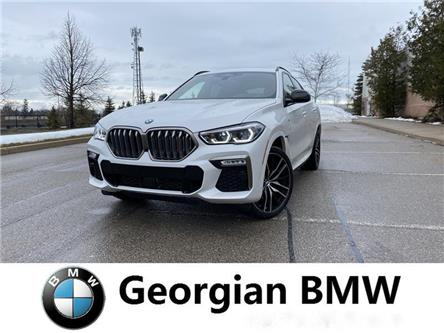 2020 BMW X6 M50i (Stk: B20067) in Barrie - Image 1 of 13