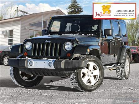 2010 Jeep Wrangler Unlimited Sahara (Stk: J19117) in Brandon - Image 1 of 27