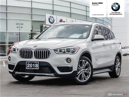 2018 BMW X1 xDrive28i (Stk: B706844A) in Oakville - Image 1 of 28