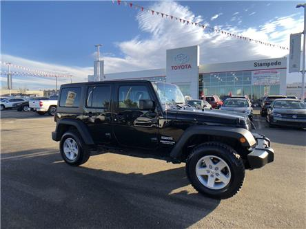 2017 Jeep Wrangler Unlimited Sport (Stk: 9020A) in Calgary - Image 1 of 25