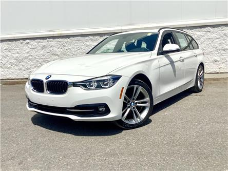 2018 BMW 330i xDrive Touring (Stk: U3450) in Ottawa - Image 1 of 23