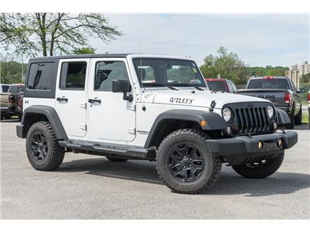 2017 Jeep Wrangler Unlimited Sport (Stk: 27478UX) in Barrie - Image 1 of 23