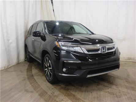 2019 Honda Pilot Touring (Stk: 1960104) in Calgary - Image 1 of 30