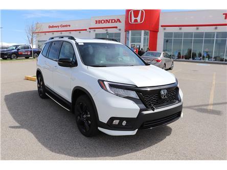 2020 Honda Passport Touring (Stk: 2200137) in Calgary - Image 1 of 10