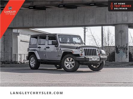 2013 Jeep Wrangler Unlimited Sahara (Stk: M614400A) in Surrey - Image 1 of 20
