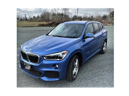 2017 BMW X1 xDrive28i (Stk: K8239) in Calgary - Image 1 of 5