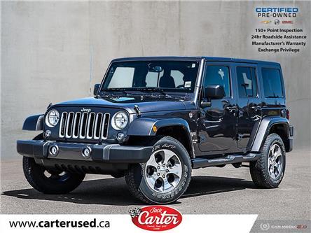 2016 Jeep Wrangler Unlimited Sahara (Stk: 28001U) in Calgary - Image 1 of 27