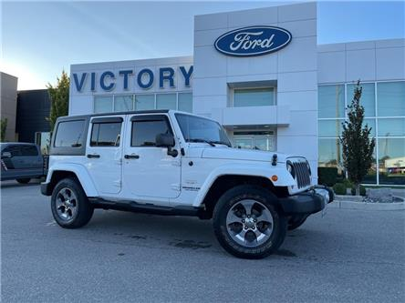 2013 Jeep Wrangler Unlimited Sahara (Stk: V4393A) in Chatham - Image 1 of 17