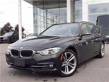 2018 BMW 330i xDrive Touring (Stk: P10067) in Gloucester - Image 1 of 14
