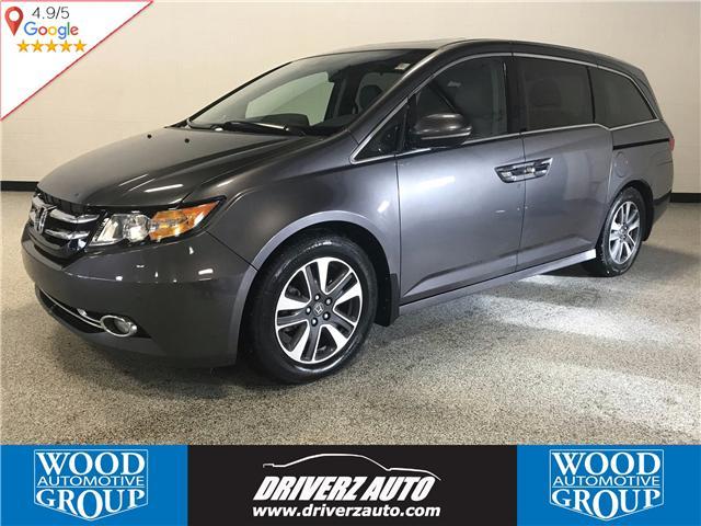2014 Honda Odyssey Touring (Stk: P11298) in Calgary - Image 1 of 13