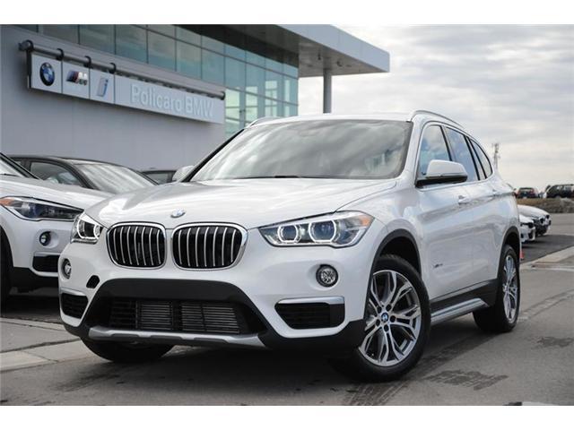 2018 BMW X1 xDrive28i (Stk: 8K31600) in Brampton - Image 1 of 11