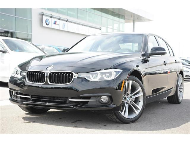 2018 BMW 330 i xDrive (Stk: 8B35584) in Brampton - Image 1 of 12