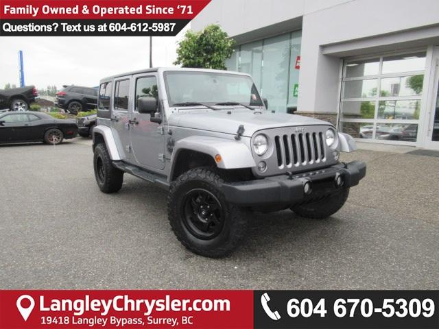 2015 Jeep Wrangler Unlimited Sahara (Stk: EE890810A) in Surrey - Image 1 of 28