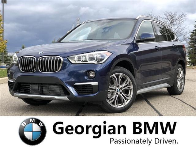 2018 BMW X1 xDrive28i (Stk: B18416) in Barrie - Image 1 of 18