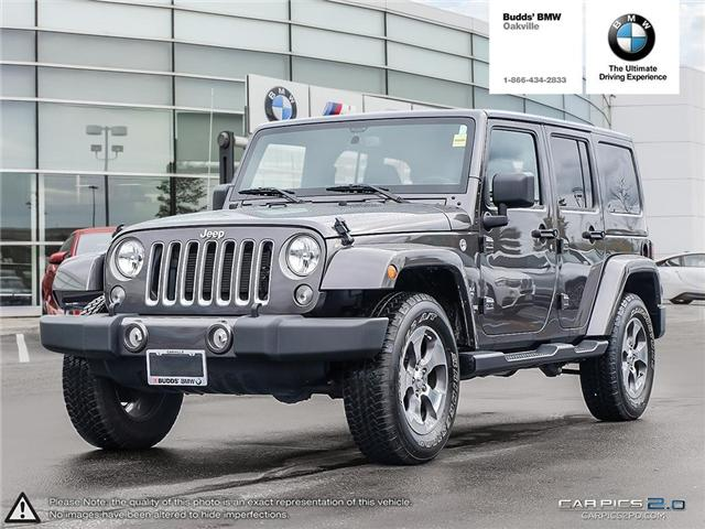 2017 Jeep Wrangler Unlimited Sahara (Stk: T675077A) in Oakville - Image 1 of 23