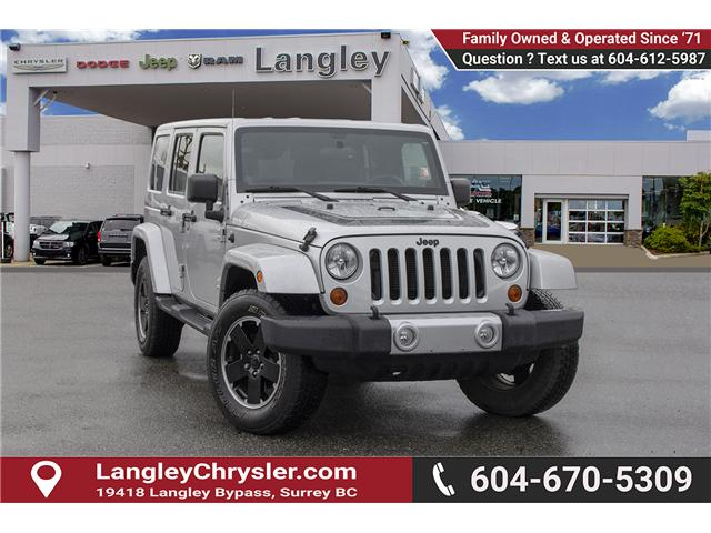 2012 Jeep Wrangler Unlimited Sahara (Stk: EE891290A) in Surrey - Image 1 of 27