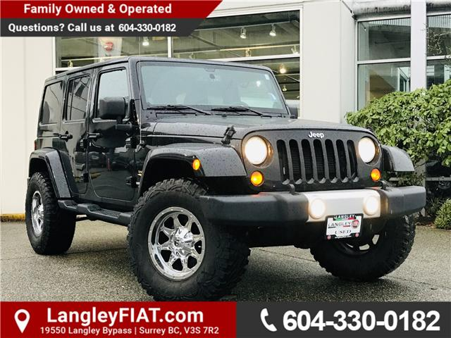 2013 Jeep Wrangler Unlimited Sahara (Stk: LF009150A) in Surrey - Image 1 of 28