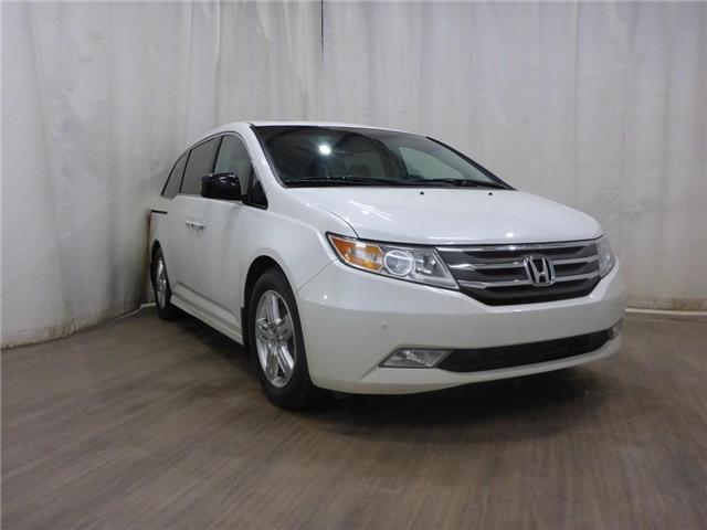 2012 Honda Odyssey Touring (Stk: 18121245) in Calgary - Image 1 of 28