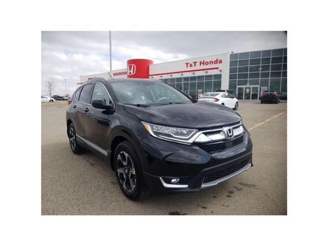 2018 Honda CR-V Touring (Stk: 2180877) in Calgary - Image 1 of 9