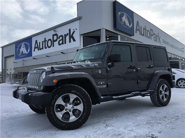 2018 Jeep Wrangler JK Unlimited Sahara (Stk: 18-73297RJB) in Barrie - Image 1 of 27